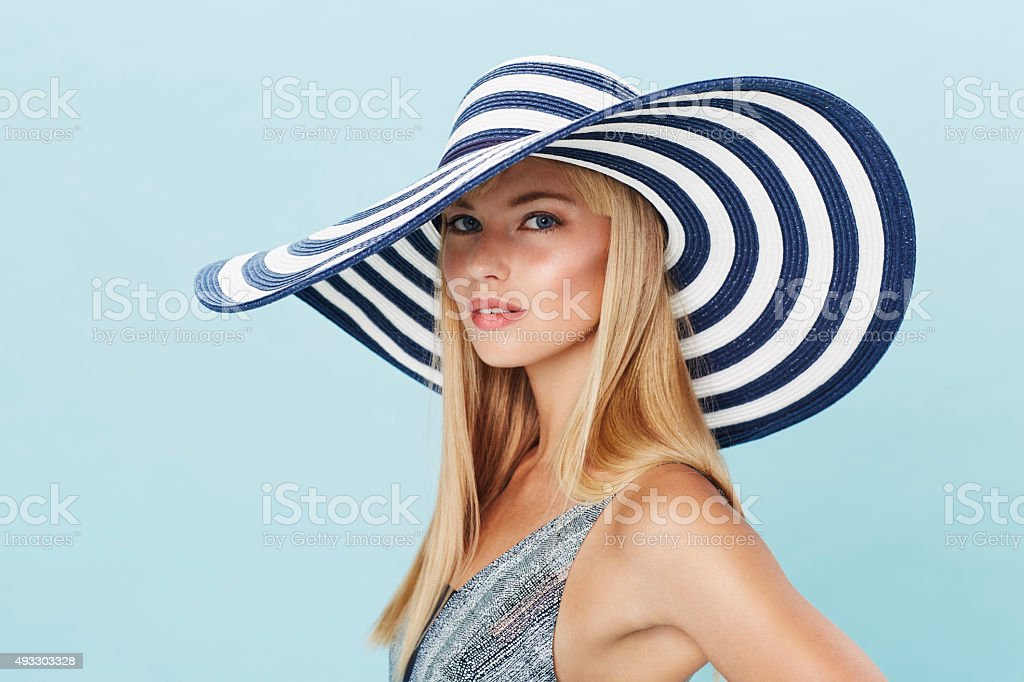 Stunning young woman in sun hat stock photo
