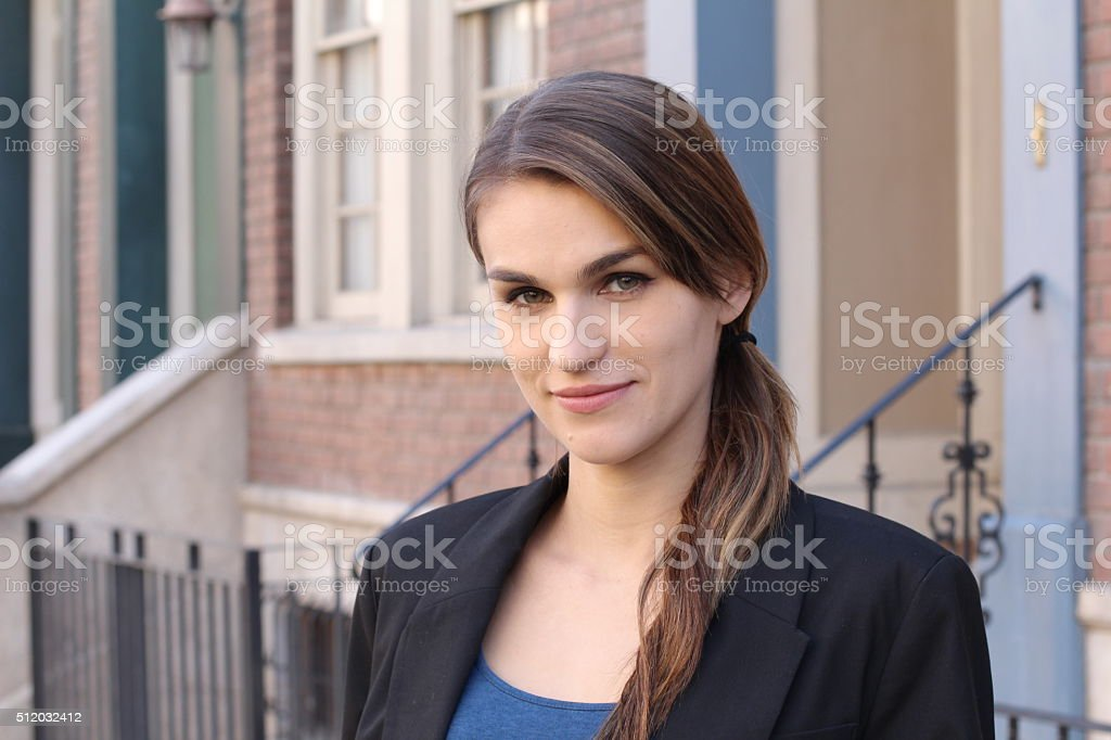 Stunning young woman with ponytail on the side stock photo