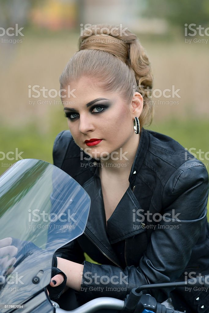 Stunning,fashionable,dangerous,angry,serious biker girl with smokey makeup stock photo