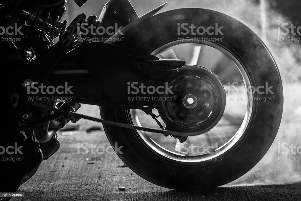 stunt rider ride and burn wheel tire stock photo
