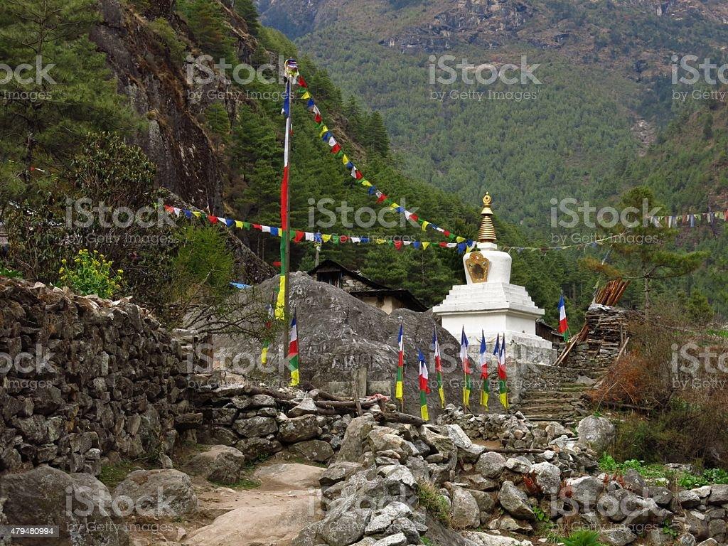 Stupa and prayer flags stock photo