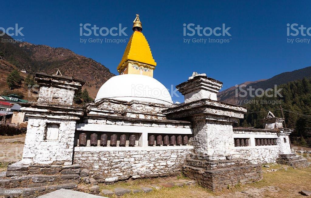 Stupa and prayer wheels in Junbesi village stock photo