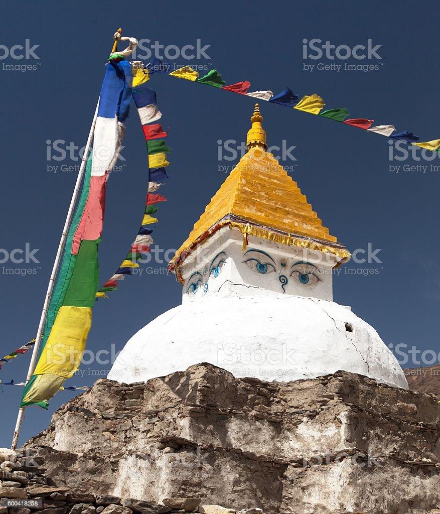 Stupa near Dingboche village with prayer flags stock photo
