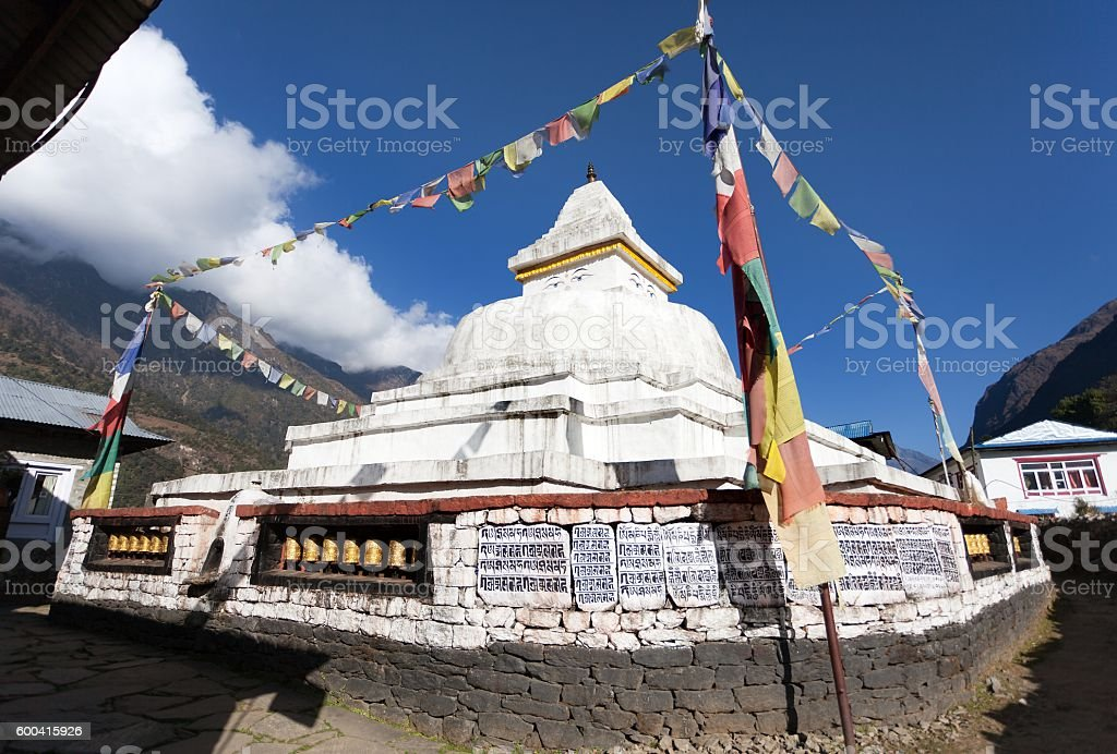 Stupa with prayer flags and wheels stock photo