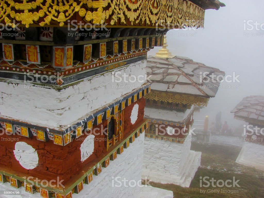 Stupas at Dochula Pass in the fog in Bhutan stock photo