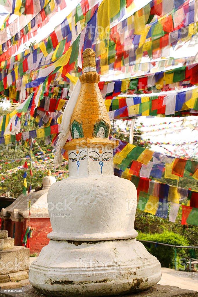 Stupas & prayer flags at Swayambhu Nath temple, Kathmandu, Nepal. stock photo