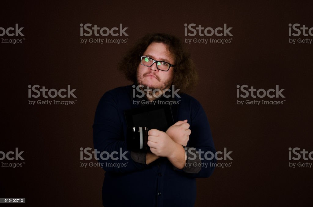 Stupid businessman with the tablet. stock photo