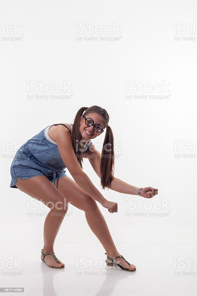 Stupid girl in dungarees stock photo