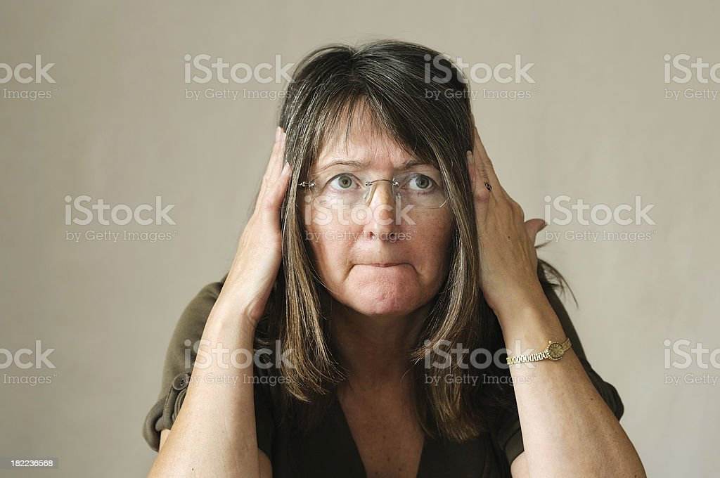 stupid woman trying to remember something stock photo