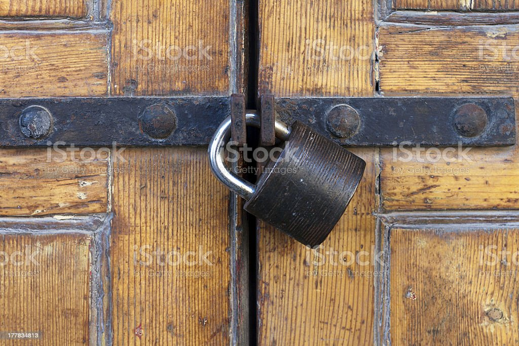 ... Sturdy padlock on polished wooden door stock photo ... & Padlocked Door Pictures Images and Stock Photos - iStock Pezcame.Com