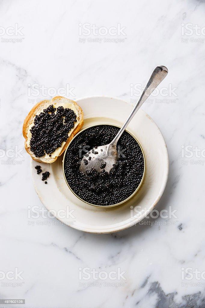 Sturgeon black caviar in can and sandwich stock photo