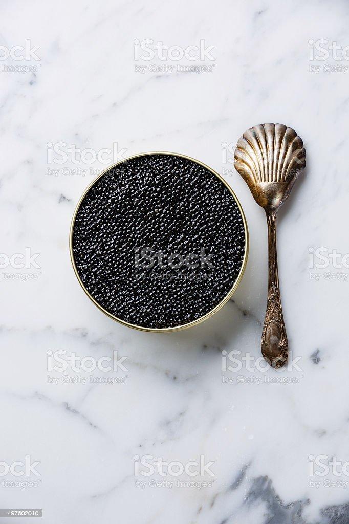 Sturgeon black caviar in can and spoon stock photo