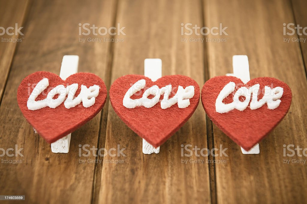 St.valentine accessories in row on wood backgroud royalty-free stock photo