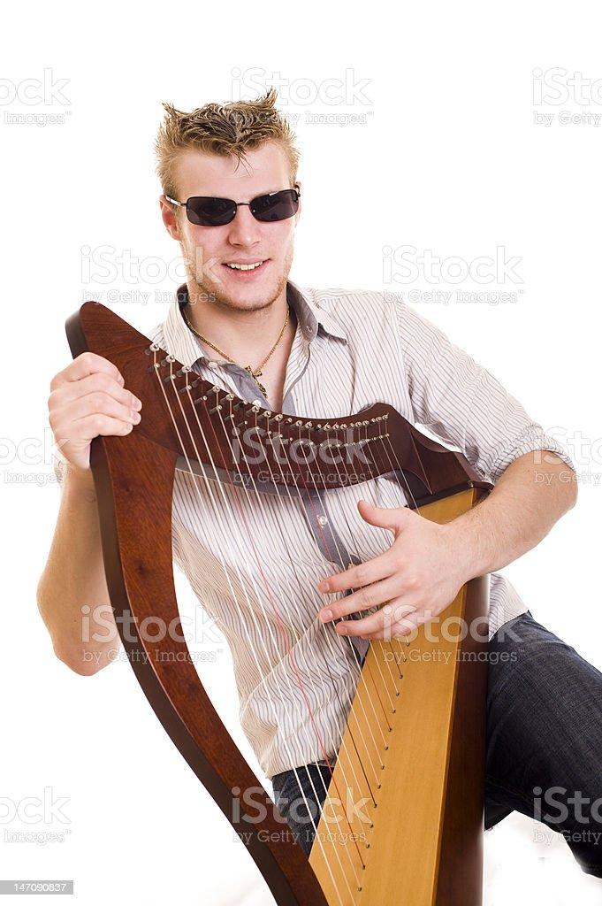 style man with harp stock photo