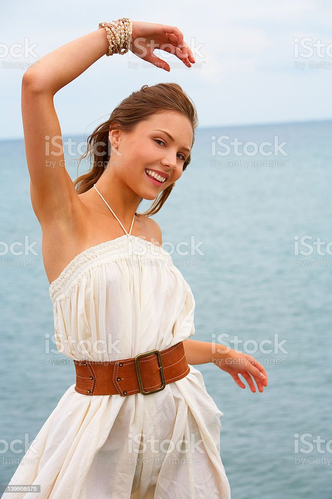 Style on beach - Happy young posing by the sea royalty-free stock photo