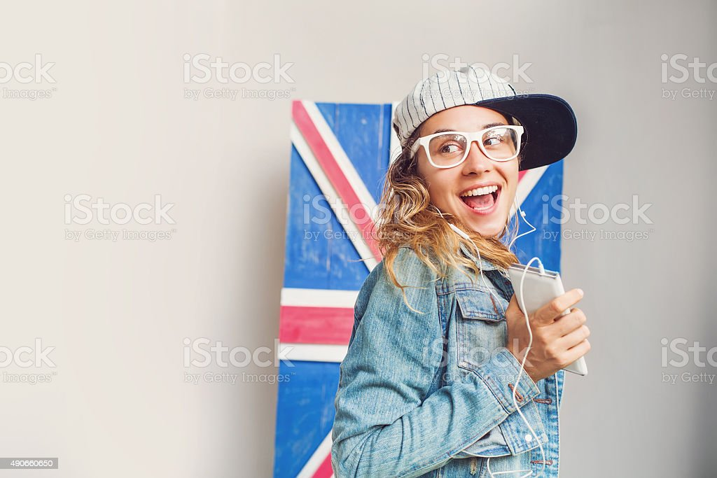 Style portrait of cute young girl witn mobile phone stock photo