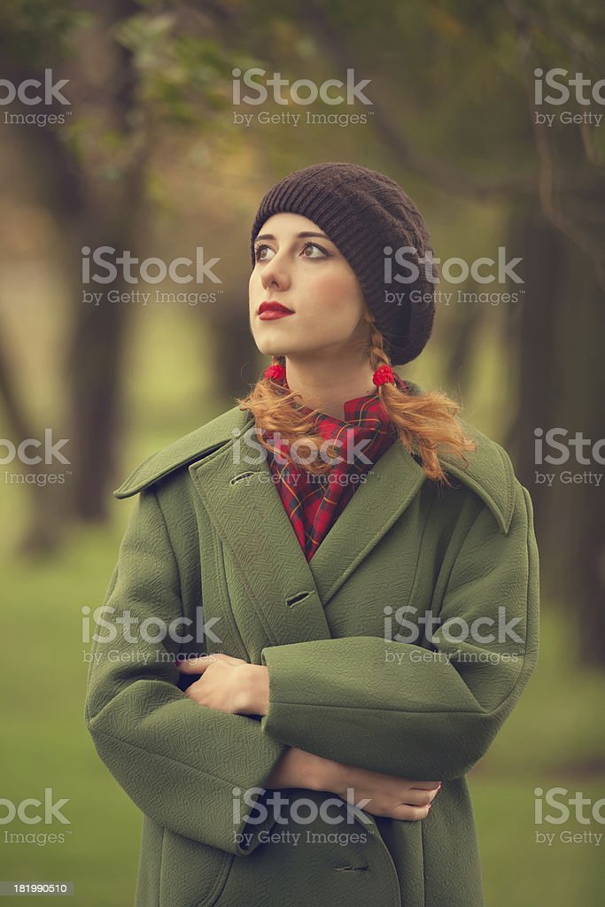 Style redhead girl at beautiful autumn alley. royalty-free stock photo