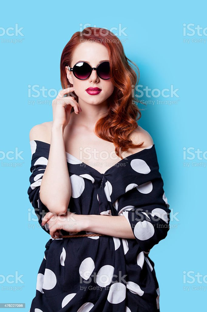 Style redhead girl in black dress stock photo