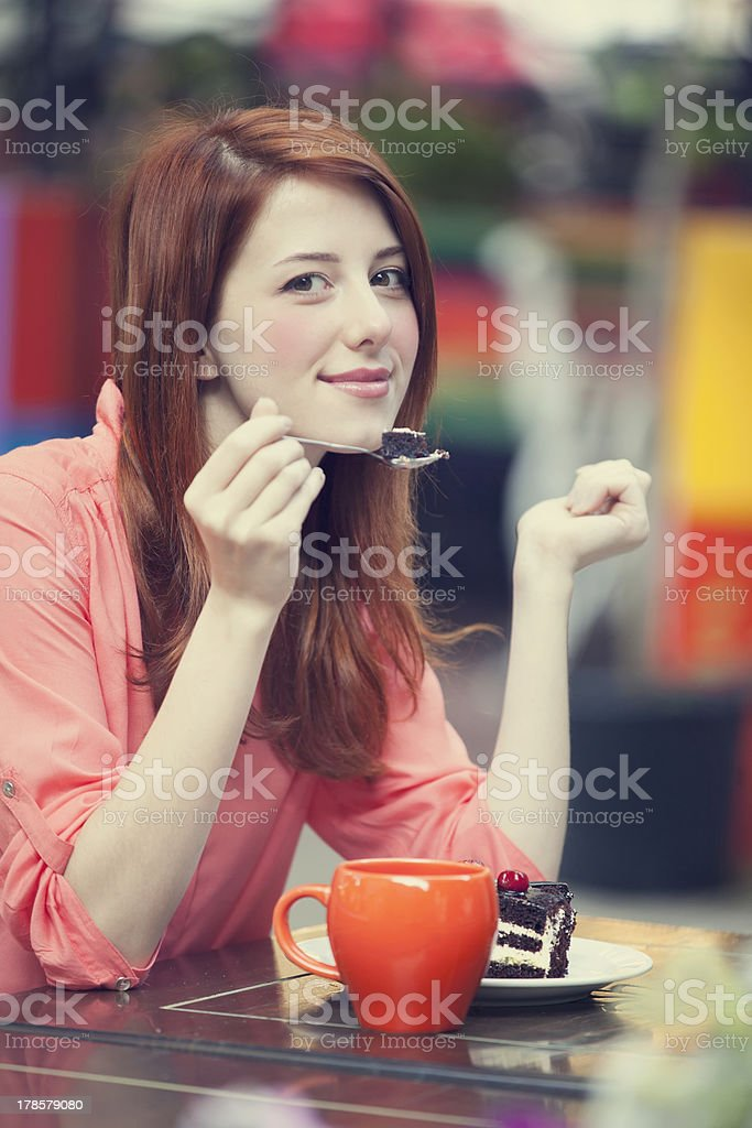 Style redhead girl with cake and cup royalty-free stock photo
