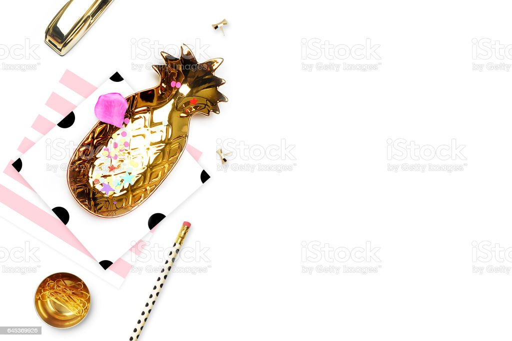 Styled background. Mock-up photo. Fashion and trendy. Flat lay. Stationery items, polka dots pattern with pineapple and pencil, gold stapler. Header for site, hero stock photo