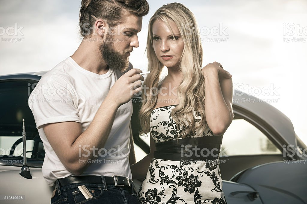 Stylish 1950s Couple Smoking Cigarette stock photo