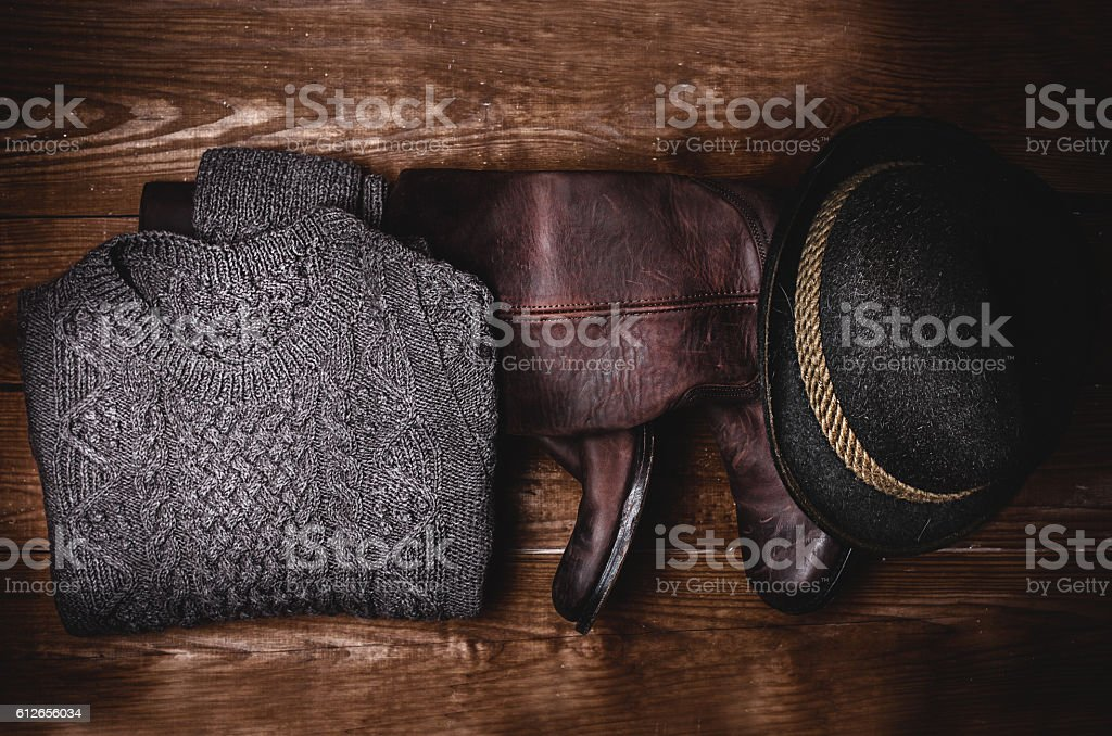 stylish accessories. Boots, sweater and hat stock photo