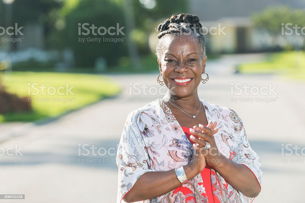 Stylish, African American woman standing outdoors stock photo