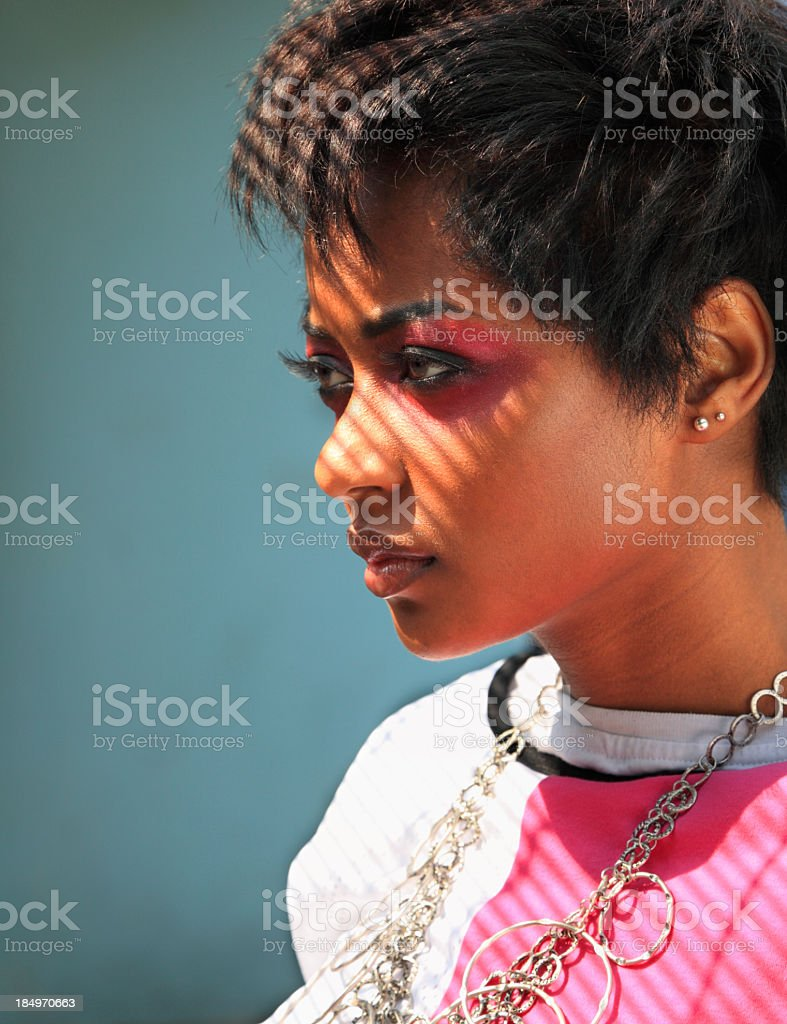 stylish afro-american sultry girl fashion model with shadows royalty-free stock photo