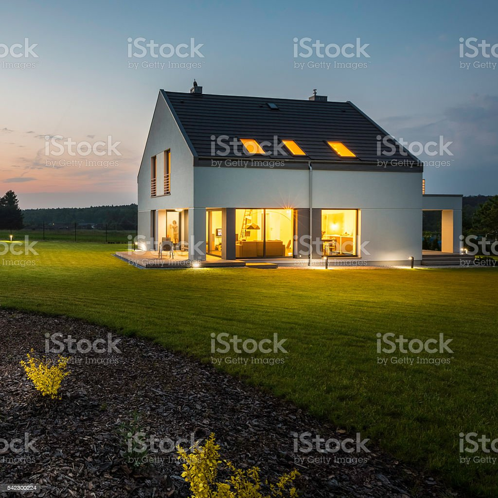 Stylish and modern house at night stock photo