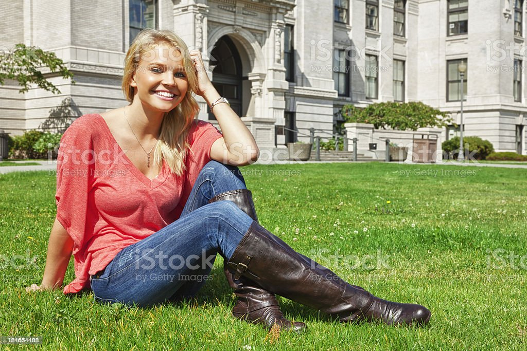Stylish Attractive Young Blonde Woman in Tall Boots royalty-free stock photo