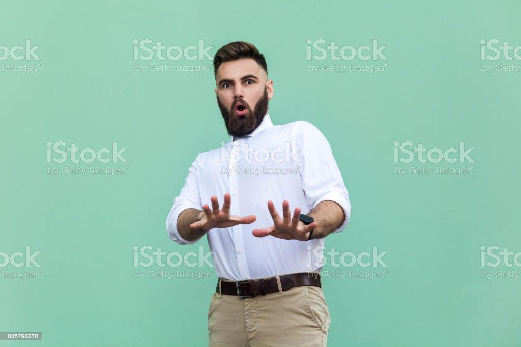 Stylish bearded man with shocked. Businessman having amazed face,...