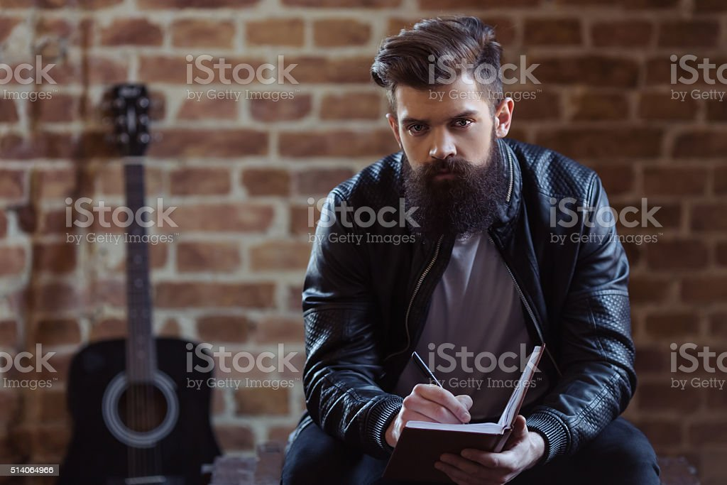 Stylish bearded musician stock photo