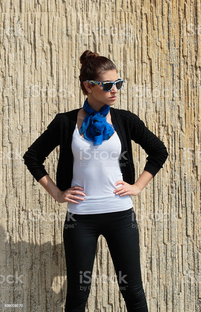 Arms akimbo stylish Russian outdoor girl fashion model with sunglasses stock photo