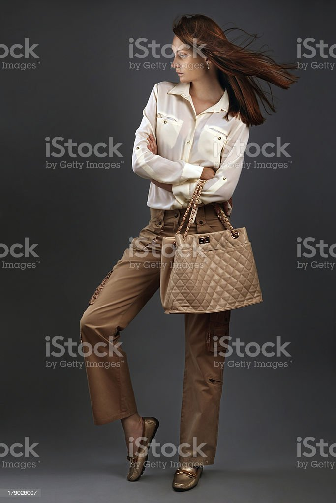 Stylish beautiful woman on grey background stock photo