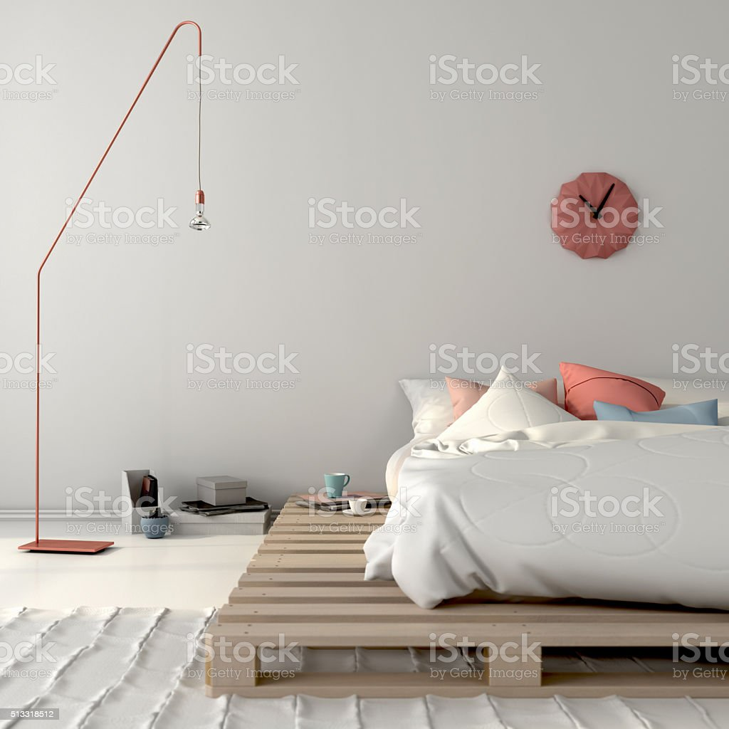 Stylish bed on wooden pallets and pink décor stock photo
