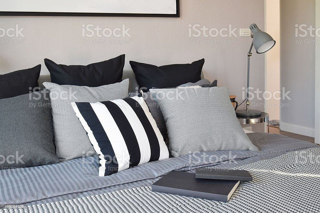 stylish bedroom interior design with black patterned pillows on stock photo