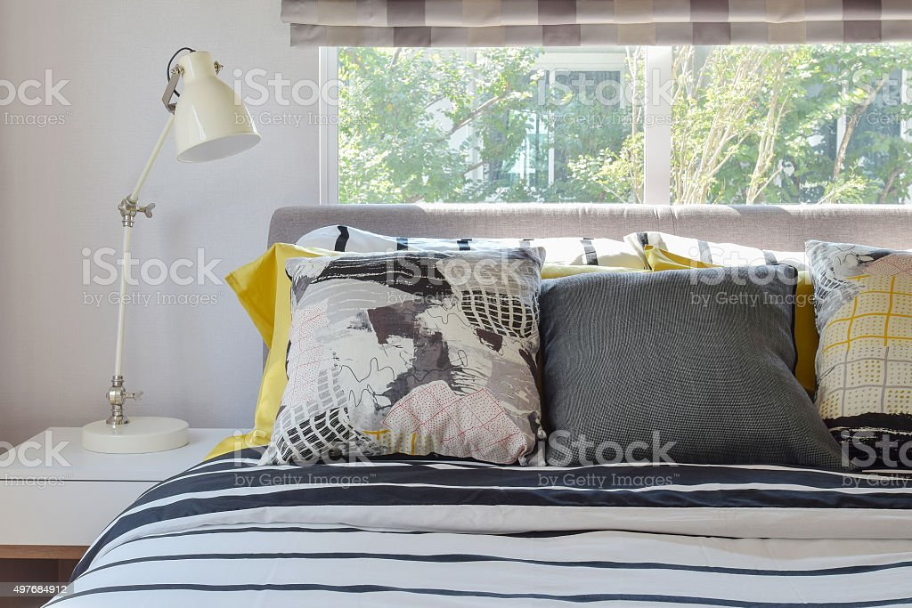 stylish bedroom interior with black and white patterned pillows stock photo
