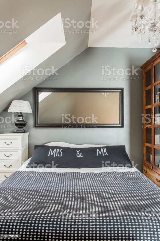 Stylish bedroom with a double bed stock photo