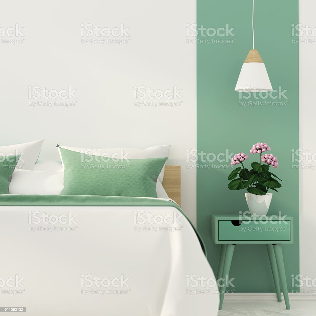 Stylish bedroom with green decoration stock photo