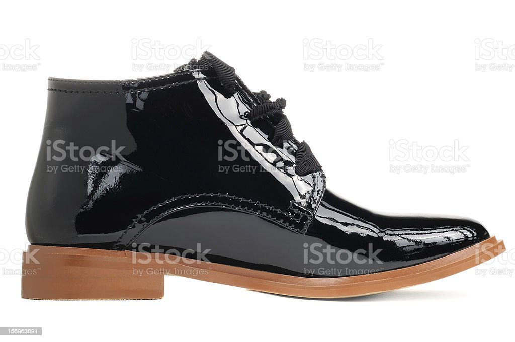 Stylish Black Patent Leather Women Ankle Boot stock photo