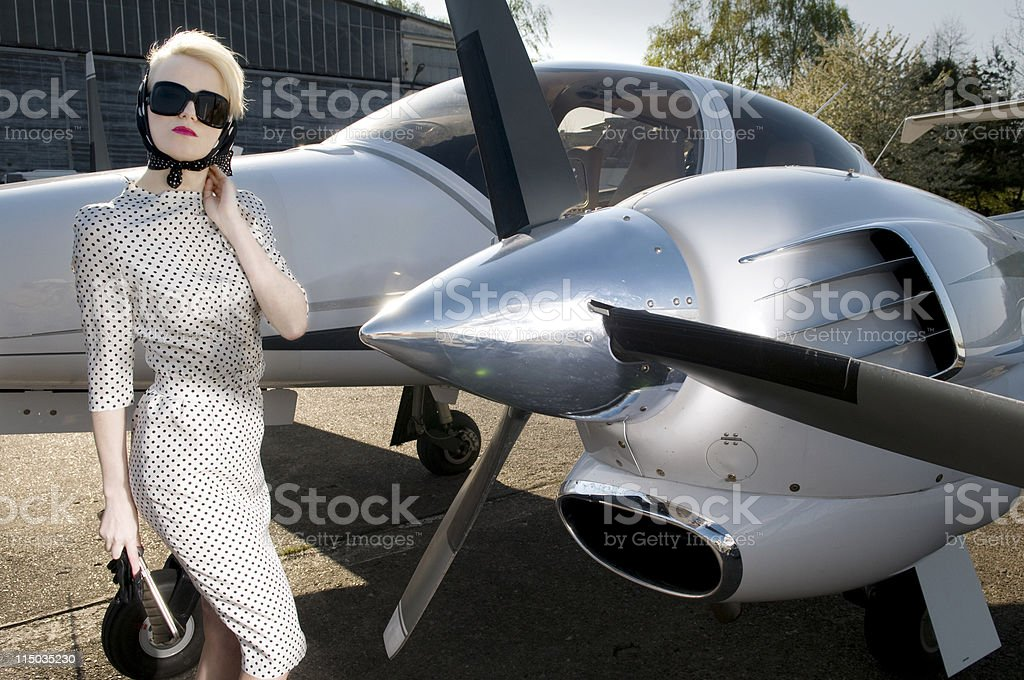 stylish blond woman in black sunglasses royalty-free stock photo