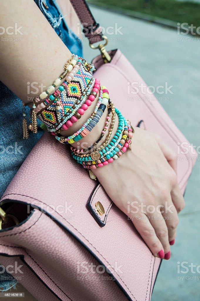 Stylish bracelets on female hand stock photo