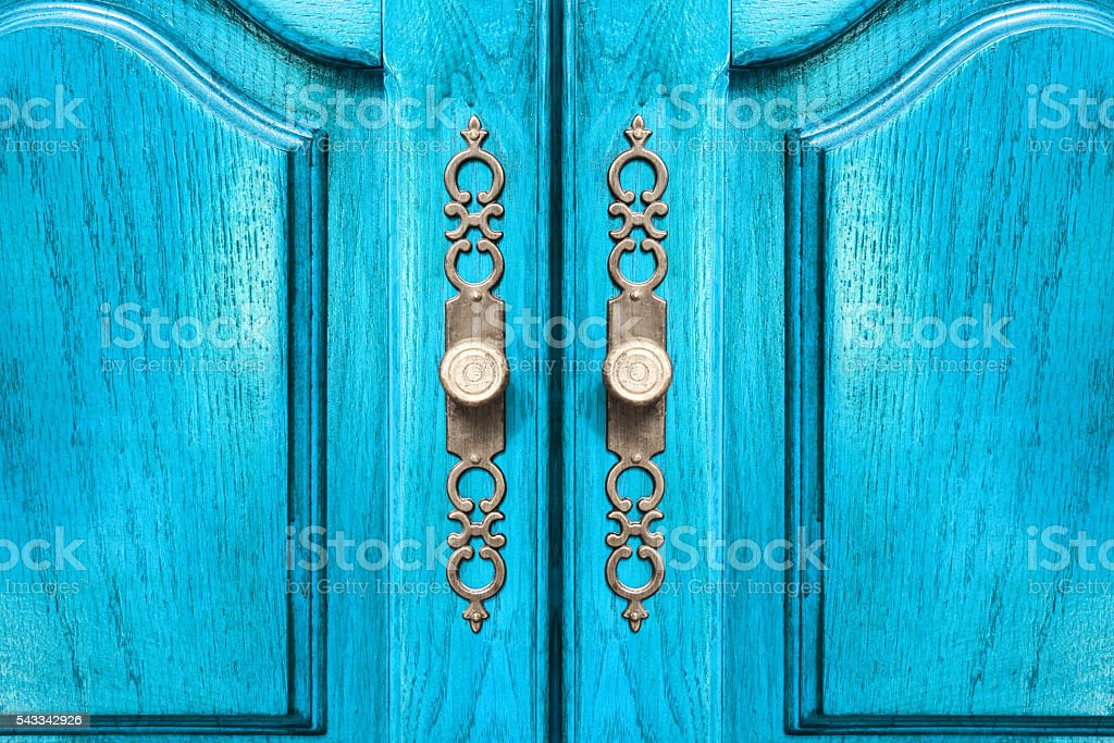 Stylish brass door handles on a cabinet or closet stock photo