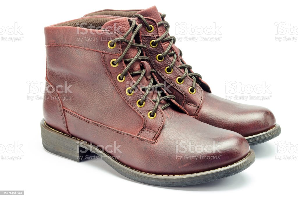 Stylish brown leather boots for men isolated on white background. stock photo