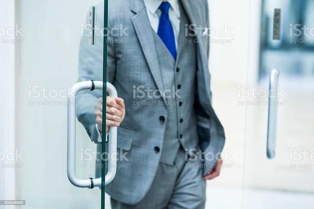 Stylish Business Executive Opening Office Door stock photo