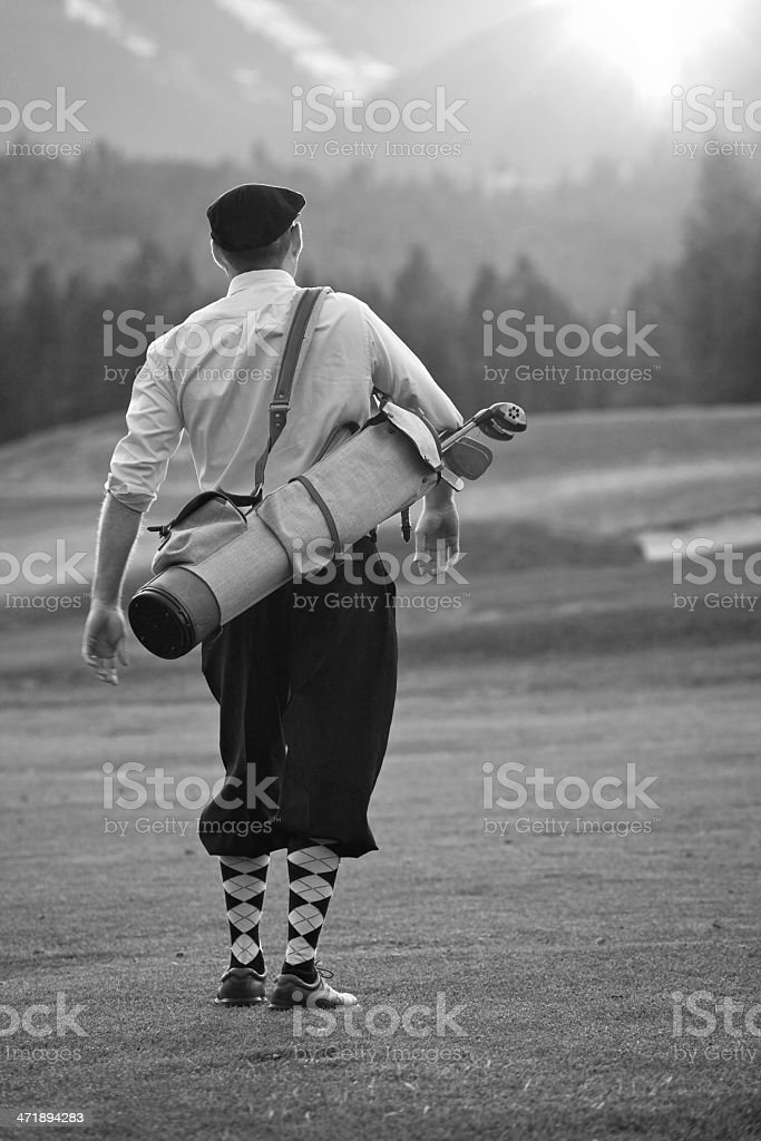 Stylish Caucasian Vintage Golfer with Plus Fours stock photo