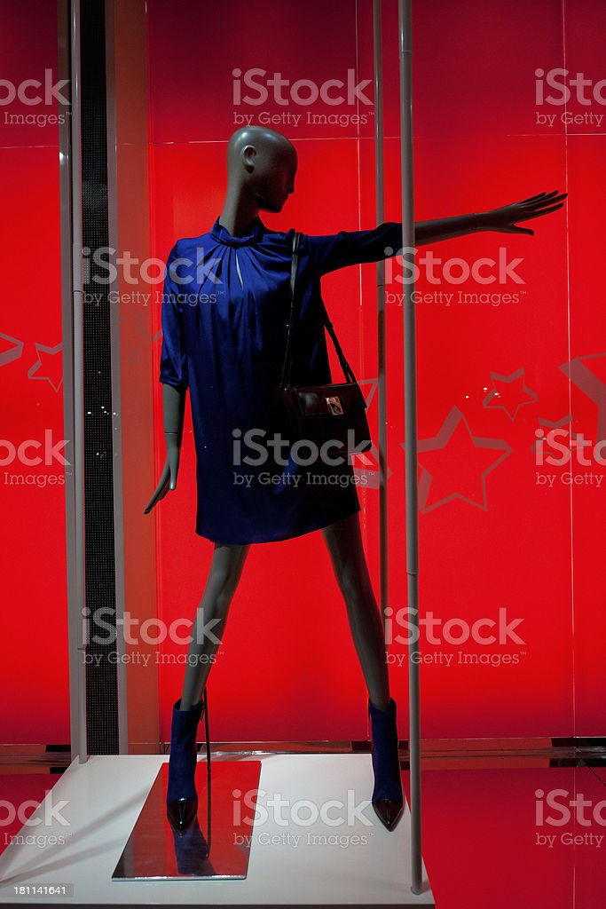 stylish clothing on mannequin in window display stock photo