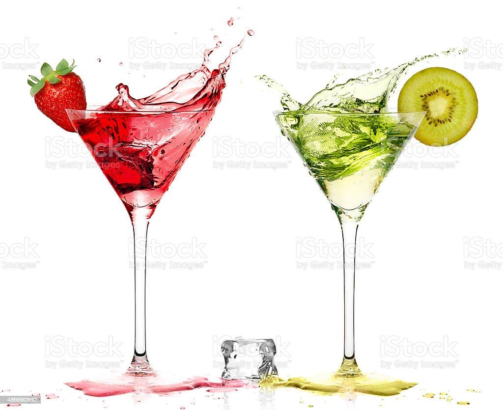 Stylish Cocktail Glass with Strawberry and Kiwi Liquor Splashing stock photo