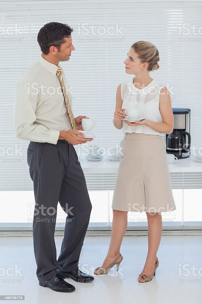 Stylish colleagues having coffee together royalty-free stock photo