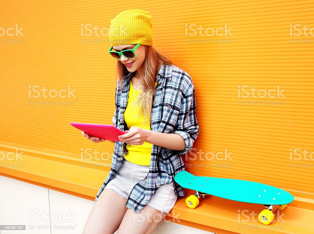 stylish cool girl using digital tablet pc in city stock photo